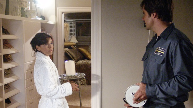 DESPERATE HOUSEWIVES - &quot;Who's That Woman?&quot; -- Cash-strapped Mrs. Huber figures out that Susan had something to do with Edie's house fire and tries to blackmail her; Carlos becomes suspicious that Gabrielle is seeing another man, but targets the wrong suspect; Lynette balks when the twins&Otilde; teacher insists the boys have ADD, and Bree struggles with her rebellious son after Rex moves out, on &quot;Desperate Housewives,&quot; SUNDAY, OCTOBER 24 (9:00-10:00 p.m., ET) on the ABC Television Network.  (ABC/DANNY FELD)EVA LONGORIA, JOHN HAYMES NEWTON