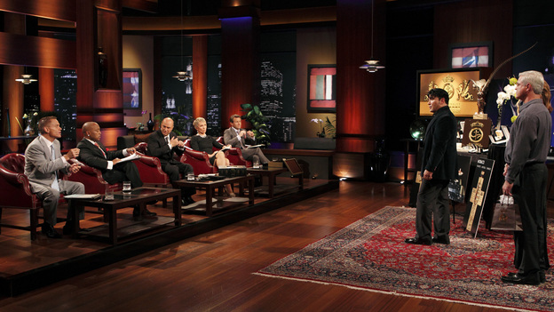 SHARK TANK - &quot;Episode 208&quot; -- A woman from Yardley, Pennsylvania could help cat lovers everywhere if the Sharks invest in her toilet training kit for cats, and the Sharks fight each other for a piece of a multi-million dollar company owned by a pharmacist from Palm Beach Gardens, Florida, who has invented a shoe with interchangeable tops. Also in this episode, an entrepreneur from Chicago is hoping to reposition her once successful designer line of maternity t-shirts; and an artist originally from Mexico City (now living in Chicago) and eager to make his American dream come true hopes the Sharks will want to invest in his line of extravagant yet affordable jewelry. In addition there will be a follow up from Season 1 on the father and son team behind Voyage Air Guitar and what happened to their business after turning down the Sharks' $1 million dollar offer, on the Season Finale of &quot;Shark Tank,&quot; FRIDAY, MAY 13 (8:00-9:00 p.m., ET) on the ABC Television Network. (ABC/CRAIG SJODIN)KEVIN HARRINGTON, DAYMOND JOHN, KEVIN O'LEARY, BARBARA CORCORAN, ROBERT HERJAVEC, ALDO ORTA (ALDO ORTA JEWELRY)
