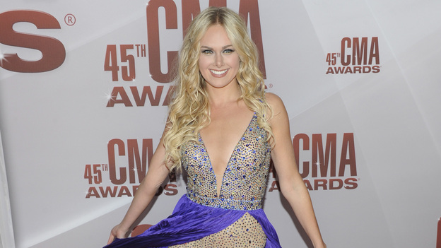 "THE 45th ANNUAL CMA AWARDS - RED CARPET ARRIVALS - ""The 45th Annual CMA Awards"" will broadcast live on ABC from the Bridgestone Arena in Nashville on WEDNESDAY, NOVEMBER 9 (8:00-11:00 p.m., ET). (ABC/JASON KEMPIN)LAURA BELL BUNDY"