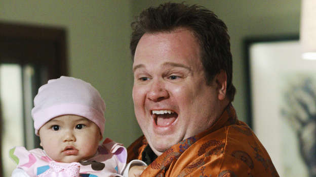 Cam, I AmCameron Tucker of Modern Family may have been a tough football player in college but he's a big softy when it comes to raising Lily. Sneaking around to avoid Mitchell's more uptight style of parenting, this stay-at-home dad is always pushing the limits of fun. From dressing up Lily in extravagant costumes to keeping her up late to watch Scarface (&quot;Say goo-goo, ga-ga to my little friend&quot;), Cam can't get enough of daddy's little girl.Click Here for more Dad Moments from Modern Family