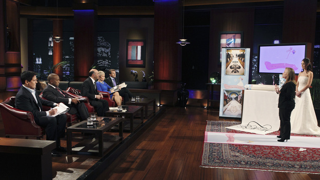 "SHARK TANK -""Episode 204"" -- Tempers flare when guest Shark Mark Cuban urges the entrepreneurs to stop negotiating with the other Sharks if they even want a chance to make a business deal with him. In this episode, a fireman from Arkansas brings an invention to the Shark Tank that could make millions and save lives; after creating an eco-friendly way to listen to music on the go, a duo from Chicago hope the Sharks will want to invest; a feisty, combative entrepreneur from Montclair, New Jersey seeks to cash in on the lucrative wedding business; and a man from Oklahoma hopes the Sharks will smell the money when he pitches his unique male-oriented brand of candles, on ""Shark Tank,"" FRIDAY, MAY 6 (8:00-9:00 p.m., ET) on the ABC Television Network. (ABC/CRAIG SJODIN)MARK CUBAN, DAYMOND JOHN, KEVIN O'LEARY, BARBARA CORCORAN, ROBERT HERJAVEC, JULIE GOLDMAN (ORIGINAL RUNNER CO.)"