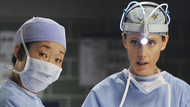 "GREY'S ANATOMY - ""Shock to the System"" -- After weeks of concealing the fact she was pregnant and miscarried, Meredith at last tells Derek and is finally cleared to return to her surgical duties in the wake of the hospital shooting spree; Cristina experiences post-traumatic stress disorder in the midst of an operation; and Bailey refuses to let Alex operate until he agrees to have the bullet in his chest removed, on ""Grey's Anatomy,"" THURSDAY, SEPTEMBER 30 (9:00-10:01 p.m., ET) on the ABC Television Network. (ABC/ERIC MCCANDLESS)SANDRA OH, KIM RAVER"